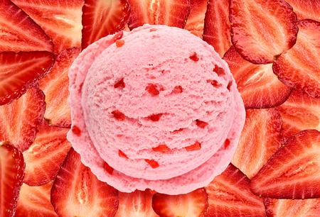 Strawberry ice cream scoop on slices background