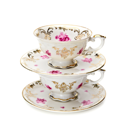 Antique tea cups stack on white background Stock Photo