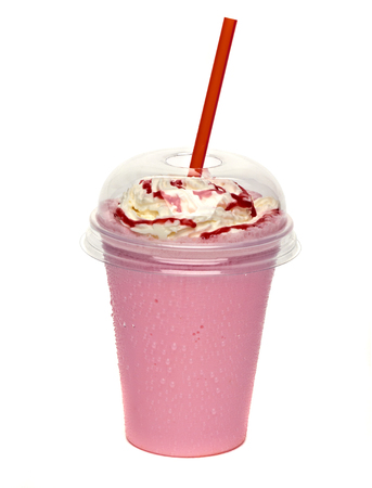 Strawberry milkshake with cream and sauce in take away cup 스톡 콘텐츠