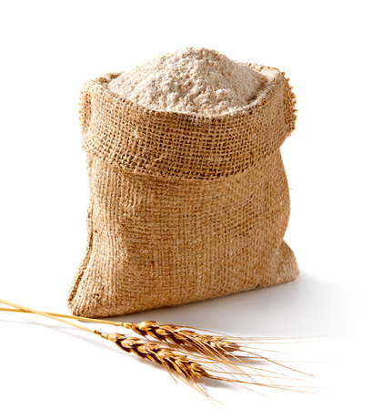 白い背景の上の小麦の耳袋に全フロア