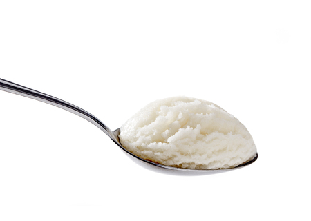 Vanilla ice cream in spoon on white background