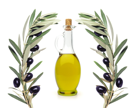 picking fruit: Olive brunches and oil bottle on white background