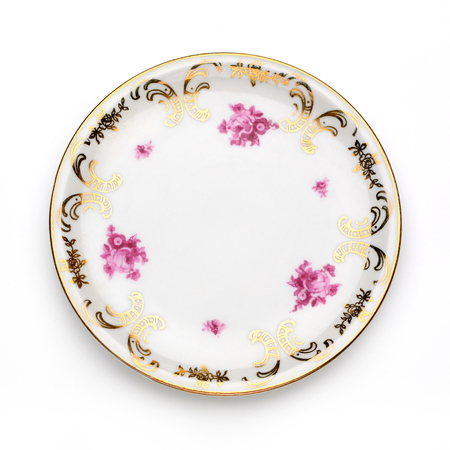 setting table: Antique plate on white background.