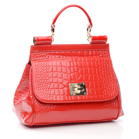 red hand: Red womens handbag on a white background.