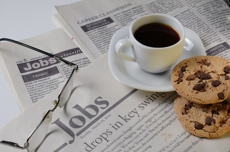 classifieds: Newspaper classifieds with cookies and coffee cup Stock Photo