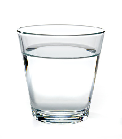 white water: Glass of water on white background. Stock Photo