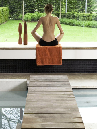 young woman relaxing in the spa welness center