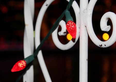 Ornamental fence with red lights Stock Photo