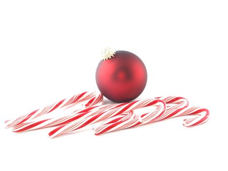 Red ball with candy canes photo