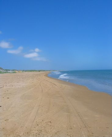 Beautiful beach with large blue sky photo