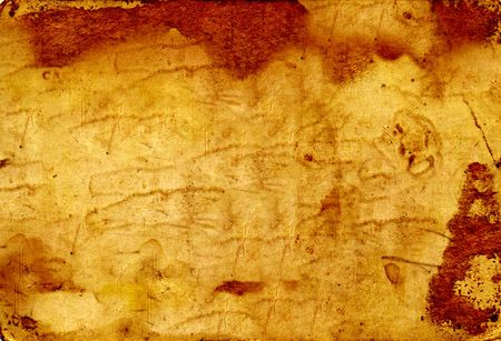 Grungy yellowed paper with stains for background photo