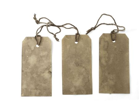 white textured paper: Three large stained tags with strings Stock Photo