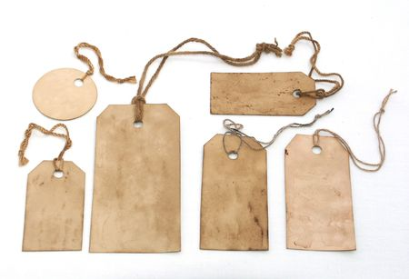 Stained tags with strings on white