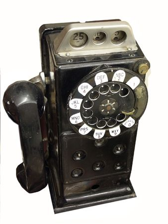 Black vintage payphone isolated on white Stock Photo