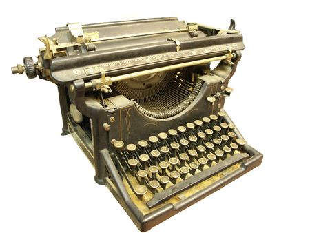 Very old typewriter isolated on white