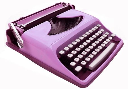 Vintage purple typewriter isolated on white photo