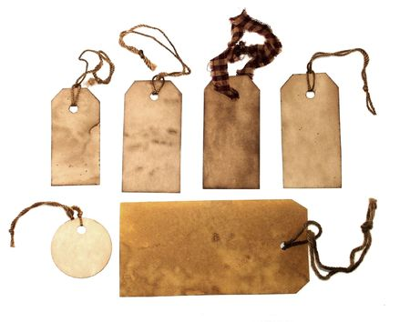 Old stained tags with strings Stock Photo