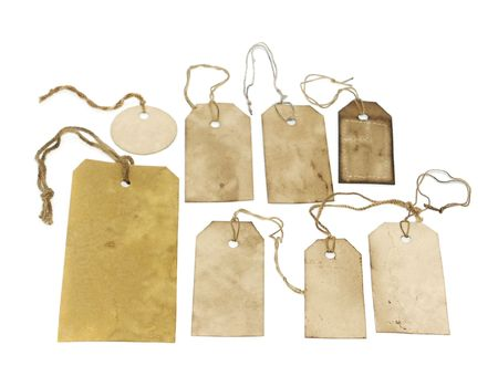 Grungy stained tags isolated on white photo