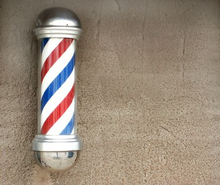 salon background: Barbers pole on an old wall