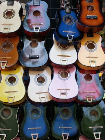 Wall of colorful guitars for background