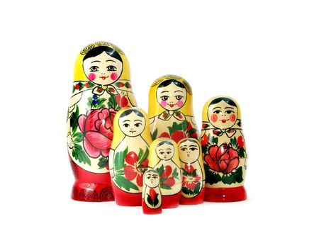 russian nesting dolls: A large group of Russian nesting dolls isolated on white