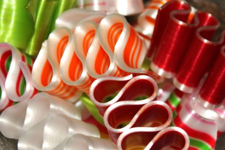 Red and orange ribbon candy closeup