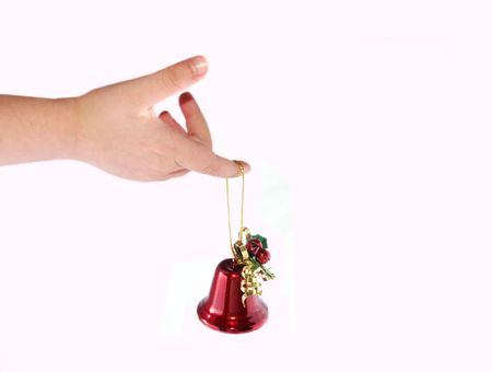 Little child holding a red Christmas bell photo