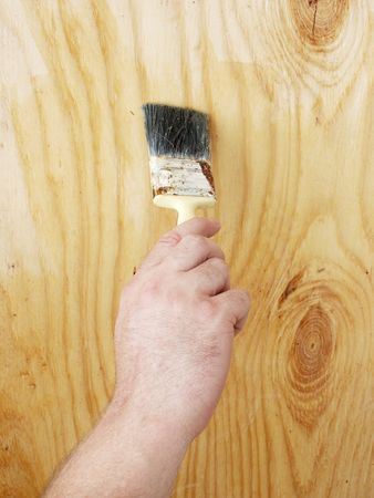 A hand with a paint brush