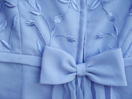 Off center blue dress bow