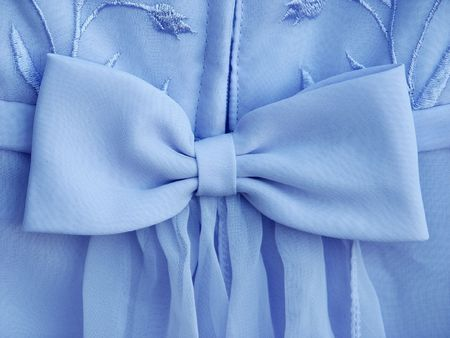 Large bright blue dress bow photo