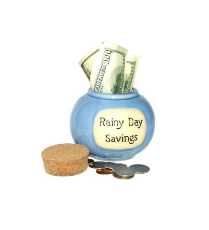 Rainy Day Savings Jar with money sticking out
