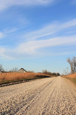 Country road with bright sky