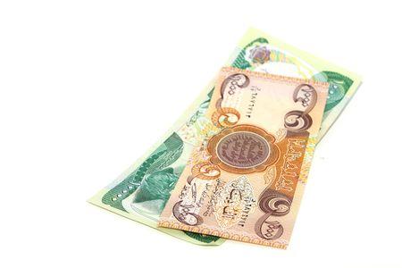 Iraqi money isolated on white