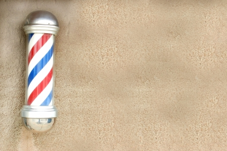 sign pole: Barbershop pole on a wall Stock Photo