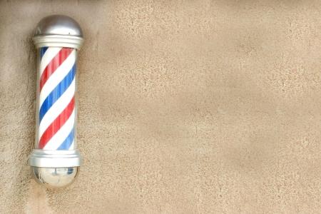 peluquero: Polo peluquer�a en una pared