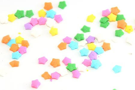 Colorful star sprinkles on white Stock Photo