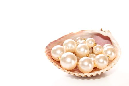 Pearls in a seashell on white background