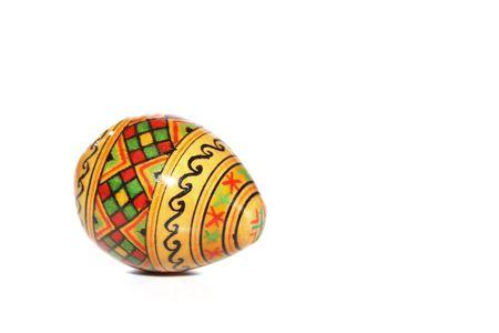 Handpainted wooden egg on white