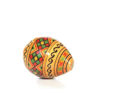 Decorated wooden egg on white