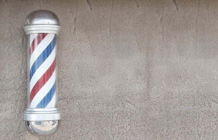 barber shave: Barbers pole with wall space for background