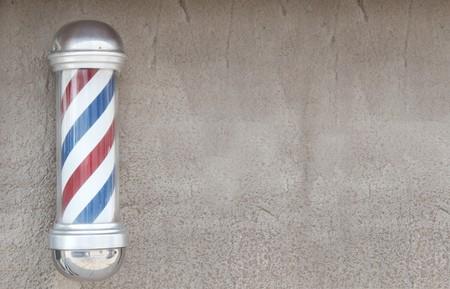 peluquero: Polo de Barber con espacio de pared de fondo  Foto de archivo