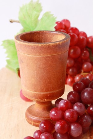 Wine glass with red grapes