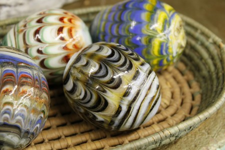 Decorated marble eggs in basket
