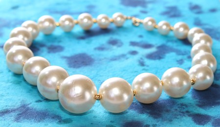 Pretty pearls on blue background