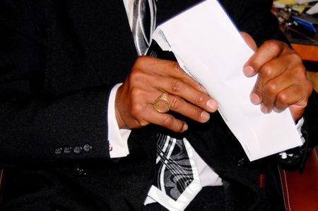 MAN OPENING A LETTER photo