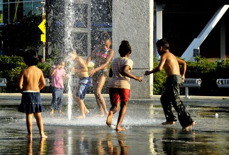 barefoot teens: CHILDREN PLAYING IN WATER