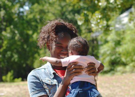 Frau mit einem Baby  Lizenzfreie Bilder
