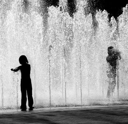 Children Playing in a Fountain photo
