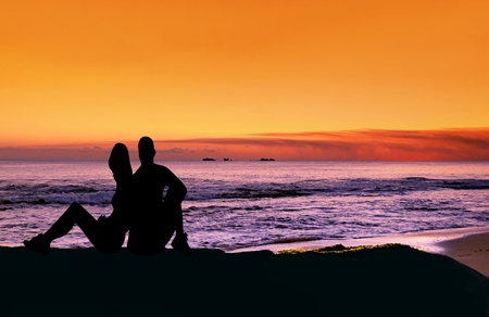 Couple on the beach at sunset  photo