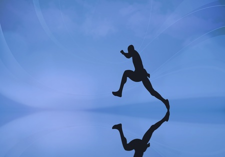 Silhouette of a male running photo